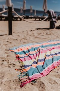 Kaboompics - Colorful beach towel on the sand