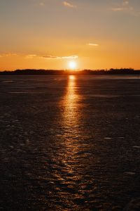 Kaboompics - Melting ice on the lake in winter at sunset