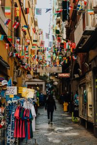 Kaboompics - Narrow street with flags of various countries, Naples