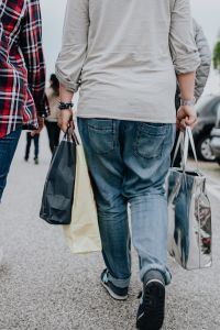 Kaboompics - Woman with shopping bags walking out from shop