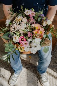 Kaboompics - A man holds a beautiful bouquet of flowers