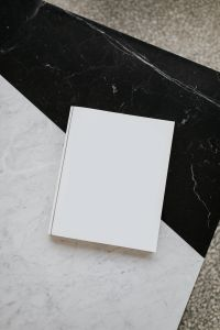 Kaboompics - Mock-up magazine or catalog on marble table