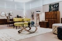 Kaboompics - Luxury livingroom interior with table, chairs, commode, poufs, rug