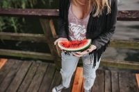 Kaboompics - Blonde woman having a healthy snack at the wooden pier