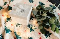 Kaboompics - White decorative gift box and eucalyptus twigs on a blanket