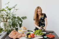 Kaboompics - Teen Girl is preparing a meal