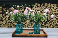 Kaboompics - Pink flowers on a wooden table in a sunny garden