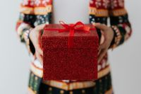 Kaboompics - Close up of man wearing a Christmas suit and hand holding red box