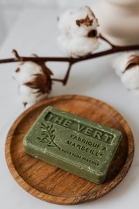 Kaboompics - Olive soap on a wooden tray