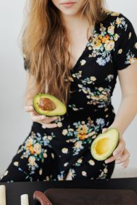 Kaboompics - Teen Girl holds the avocado