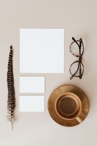 Blank cards & coffee on beige background