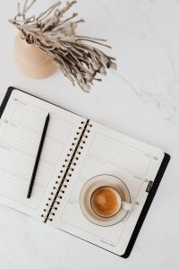 Kaboompics - Coffee - Weekly Planner & Vase on Marble