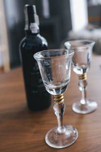 Kaboompics - Two empty wine glasses with a bottle of wine on a table