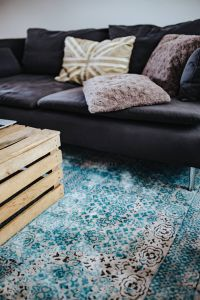 Kaboompics - Designer living room interior with a wooden box table and a light blue carpet