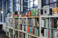 Kaboompics - Rows of different colorful books lying on the shelves in the modern urban bookshop