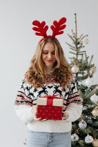 Kaboompics - Woman with Gifts Wearing Christmas Sweater and Reindeer Horns on Head