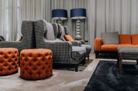 Kaboompics - Pouf, cozy armchairs and sofa in living room