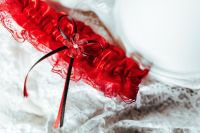 Kaboompics - Red garter close-up
