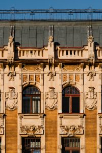 Kaboompics - The facade of an old orange tenement house at Piotrkowska Street in Łódź, Poland
