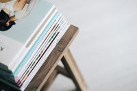 Kaboompics - Stack of magazines on the wooden stool