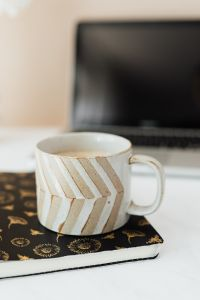 Kaboompics - Laptop - organizer & cup of coffee on marble table