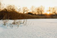 Kaboompics - Sunset over a frozen lake - background - wallpaper
