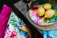 Kaboompics - Lemons on colorful plate, tropical pillows
