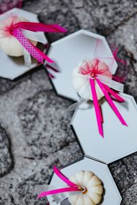 Kaboompics - Decorative white pumpkin trinkets with ribbons on the floor