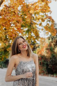 Kaboompics - Blond Woman in a Sequin Dress is Holding a Glass of Champagne, Autumn