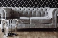 Kaboompics - Elegant grey sofa and a table