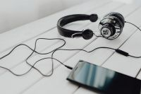 Kaboompics - Black smartphone and headphones with various items