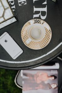 Kaboompics - Top view of table with coffee, mobile hone and magazine