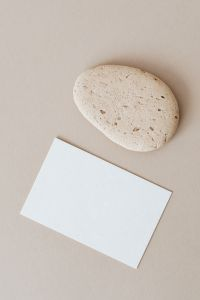 Kaboompics - Blank card & rock on beige background