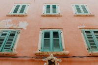 Kaboompics - Pastel pink building with green shutters, Rovinj, Croatia