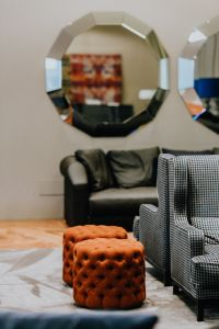 Kaboompics - Orange poufs and big mirror