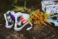 Kaboompics - Yellow flowers with comic book sneakers