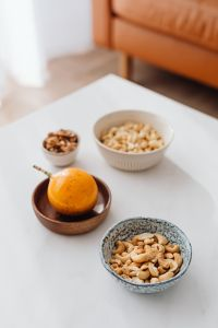 Kaboompics - Cashew nuts and passion fruit - maracuja - passionfruit