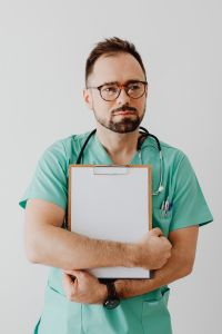Kaboompics - Doctor with stethoscope and clipboard