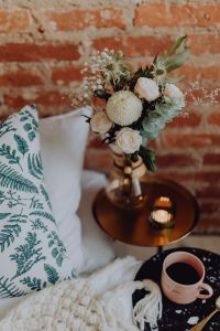 Kaboompics - A bouquet of flowers and a cup of coffee on the bedside table