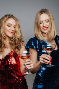 Kaboompics - Two Women in Green and Red Dress Holding Glass of Wine