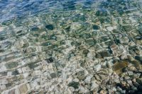 Kaboompics - A close-up of stones in turquoise water, Isola, Slovenia