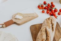 Kaboompics - Bread- tomatoes & cheese on cutting board
