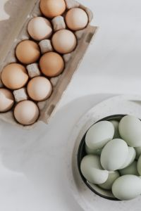 Kaboompics - Easter flat lay with green eggs on a white marble