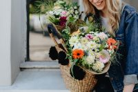 Kaboompics - Young woman with basket full of flowers