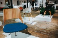 Kaboompics - Various designer chairs and tables on an exhibition