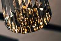 Kaboompics - Elegant black designer chandelier with a lit lightbulb