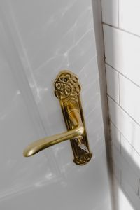Kaboompics - Antique gold plated door handle