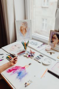 Kaboompics - A woman paints with watercolors