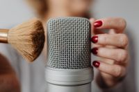 Kaboompics - Woman Recording ASMR Sounds On Microphone