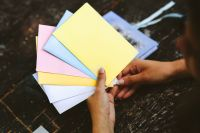Kaboompics - Woman holding colourful envelopes